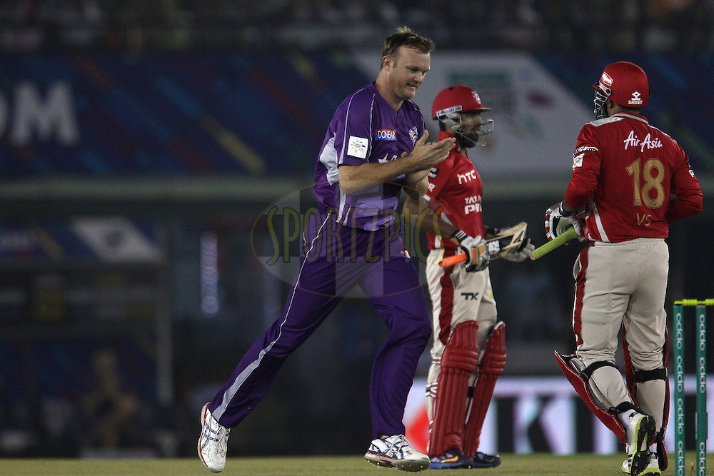 Doug BOLLINGER of the Hobart Hurricanes celebrates the wicket of Virender SEHWAG of the Kings XI Punjab with his first ball during match 2 of the Oppo Champions League Twenty20 between the Kings XI Punjab and the Hobart Hurricanes held at the Punjab Cricket Association Stadium, Mohali, India on the 18th September 2014<br /> <br /> Photo by:  Ron Gaunt / Sportzpics/ CLT20<br /> <br /> <br /> Image use is subject to the terms and conditions as laid out by the BCCI/ CLT20.  The terms and conditions can be downloaded here:<br /> <br /> http://sportzpics.photoshelter.com/gallery/CLT20-Image-Terms-and-Conditions-2014/G0000IfNJn535VPU/C0000QhhKadWcjYs