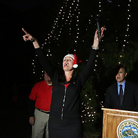 Lori Harris, Executive Director of the Greenfield Lake Collaborative points in the direction of Santa Claus after the Greenfield Christmas Tree lighting at Greenfield Lake Park Thursday December 4, 2014 in Wilmington, N.C. (Jason A. Frizzelle)