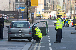 ©Licensed to London News Pictures 06/02/2020<br /> Croydon, UK. Police around the car which has a smashed window. Parts of Croydon town centre near East Croydon station have been closed and cordoned off by police while they investigate an abandoned vehicle which has been parked on the pavement.  Photo credit: Grant Falvey/LNP