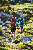 Backpackers Alexa Ault, Kaitlyn Honnold, Chris Call and Kevin Luby head to camp, Stough Creek Basin, Wind River Range, Wyoming.