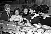 29/03/1963<br /> 03/29/1963<br /> 29 March 1963<br /> Fashion models visit Bolands Biscuit Factory at Deansgrange, Dublin. The crackers line.