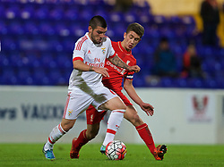 CHESTER, ENGLAND - Friday, October 23, 2015: Liverpool's captain Cameron Brannagan in action against Benfica's Pedro Rebocho during the Premier League International Cup match at the Deva Stadium. (Pic by David Rawcliffe/Propaganda)