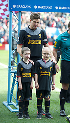 BIRMINGHAM, ENGLAND - Easter Sunday, March 31, 2013: Liverpool's captain Steven Gerrard with mascot Joshua Jackson before the Premiership match against Aston Villa at Villa Park. (Pic by David Rawcliffe/Propaganda)