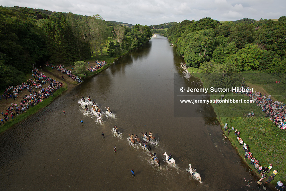 The horsemen fording the River Tweed on the ride-out, at Galafoot, during the Gala Braw Lads Gathering, with Braw Lad Daniel Whitehead, in Galashiels, Scotland, Saturday 29th June 2013.<br /> N55&deg;36.201'<br /> W2&deg;46.805'