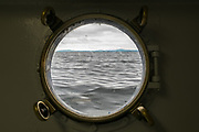 The sea as seen through a porthole in a ship