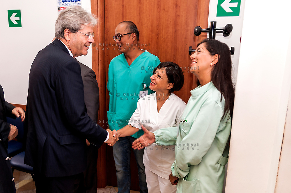 ROME, ITALY - SEPTEMBER 01: Italian PM Paolo Gentiloni with the voluntary during visit the Citadel of the Charity of the Diocesan Caritas of Rome on September 1, 2017 in Rome, Italy. Italian PM Paolo Gentiloni visited the Caritas to express the gratitude of all Italians to the world of volunteering, to those who work in favour of solidarity.