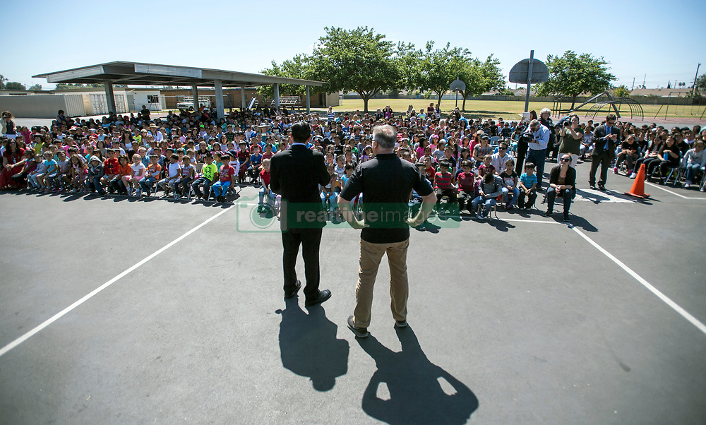 May 2, 2017 - Westminster, California, USA - Carlos Primiani, left, stands with county superintendent of school Dr. Al Mija?res, as Primiani is surprised with a 2018 Teacher of the Year award in Westminster, California, on Tuesday, May 2, 2017. ..Primiani, a 6th grade teacher at Leo Carrillo Elementary School, is one of six teachers who were surprised with the honor by county superintendent of school Dr. Al Mija?res. ..(Photo by Jeff Gritchen, Orange County Register/SCNG) (Credit Image: © Jeff Gritchen, Jeff Gritchen/The Orange County Register via ZUMA Wire)