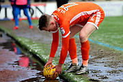 Shrewsbury Town defender Luke Hendrie (17) retrieves the ball during the EFL Sky Bet League 1 match between Scunthorpe United and Shrewsbury Town at Glanford Park, Scunthorpe, England on 17 March 2018. Picture by Mick Atkins.