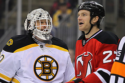 Jan 19; Newark, NJ, USA; New Jersey Devils right wing David Clarkson (23) and Boston Bruins goalie Tim Thomas (30) talk during the second period at the Prudential Center.