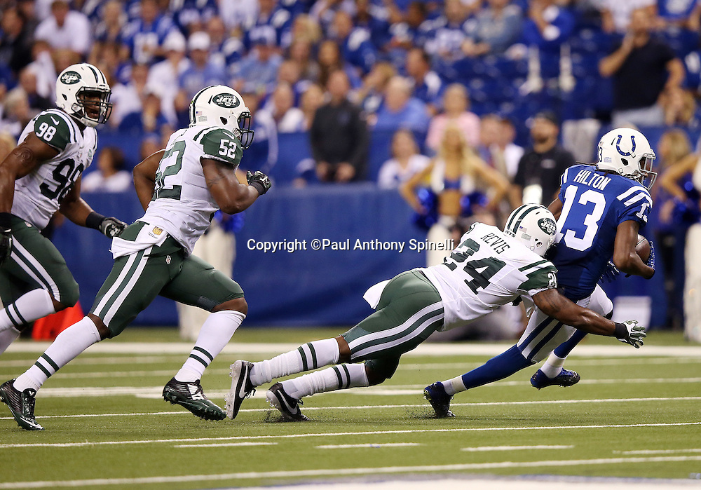 New York Jets cornerback Darrelle Revis (24) dives and tackles Indianapolis Colts wide receiver T.Y. Hilton (13) after a third quarter pass reception during the 2015 NFL week 2 regular season football game against the Indianapolis Colts on Monday, Sept. 21, 2015 in Indianapolis. The Jets won the game 20-7. (©Paul Anthony Spinelli)