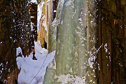 Ice climber in The Flume in Franconia Notch State Park. New Hampshire's White Mountains.
