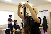 Prisoners getting their hair cut by fellow inmates who are learning to be hairdressers.. HMP Styal, Wilmslow, Cheshire