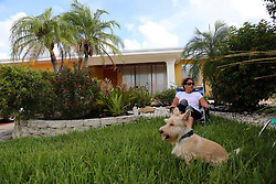 Carol Schumacher, who plans to ride out the storm with her husband, Bob, and dog Casey in their Lauderdale-By-The-Sea home, sits in a lawn chair in her front yard as her husband finished up Hurricane Irma preparation on Friday, Sept. 8, 2017.   (Amy Beth Bennett /Sun Sentinel/TNS/Sipa USA)<br />SOUTH FLORIDA OUT; NO MAGS; NO SALES; NO INTERNET; NO TV
