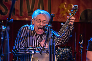 Peter Stampfel displaying high energy at the Brooklyn Folk Festival. Stampfel has been in bands including the Holy Modal Rounders and the Clamtones,