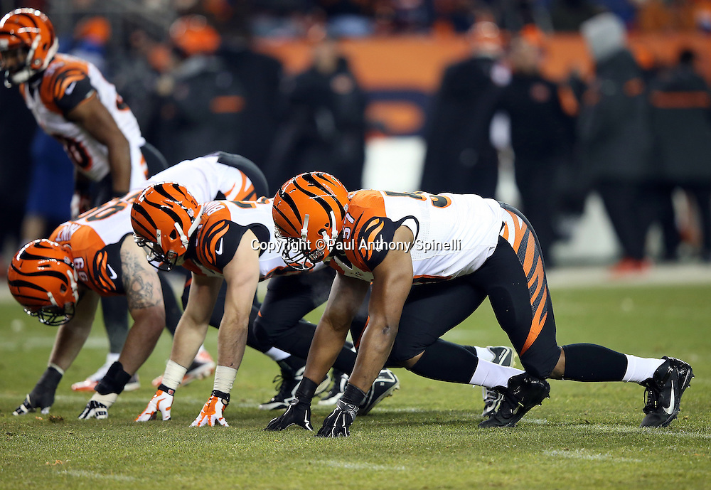 Cincinnati Bengals outside linebacker Vincent Rey (57) and a pair of teammates get ready to rush on special teams punt coverage during the 2015 NFL week 16 regular season football game against the Denver Broncos on Monday, Dec. 28, 2015 in Denver. The Broncos won the game in overtime 20-17. (©Paul Anthony Spinelli)