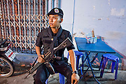"24 SEPTEMBER 2009 -- PATTANI, THAILAND: A Thai Ranger in the night market in Pattani, Thailand. The Rangers are a paramilitary force used for border protection and internal security in Thailand. They are under the command of the Thai army. Thailand's three southern most provinces; Yala, Pattani and Narathiwat are often called ""restive"" and a decades long Muslim insurgency has gained traction recently. Nearly 4,000 people have been killed since 2004. The three southern provinces are under emergency control and there are more than 60,000 Thai military, police and paramilitary militia forces trying to keep the peace battling insurgents who favor car bombs and assassination.  PHOTO BY JACK KURTZ"