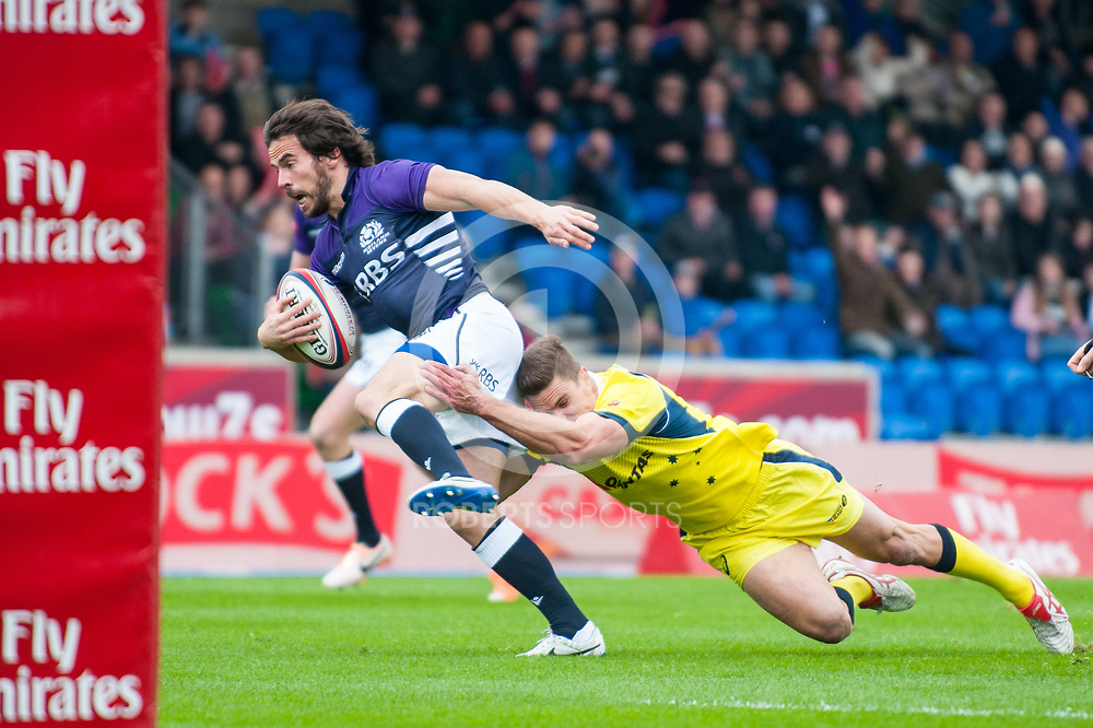 Scotland's Colin Gregor burst through the Australian defence to score a try. Action from the IRB Emirates Airline Glasgow 7s at Scotstoun in Glasgow. 3 May 2014. (c) Paul J Roberts / Sportpix.org.uk