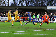 Lyle Taylor of AFC Wimbledon has a rare opportunity to give AFC Wimbledon the lead during the Sky Bet League 2 match between AFC Wimbledon and Bristol Rovers at the Cherry Red Records Stadium, Kingston, England on 26 December 2015. Photo by Stuart Butcher.