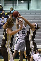 17 December 2011:  Taylor Reaber struggles against a defender to take a shot during an NCAA womens division 3 basketball game between the St. Francis Fighting Saints and the Illinois Wesleyan Titans in Shirk Center, Bloomington IL
