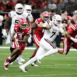 Aug 31, 2019; New Orleans, LA, USA; Mississippi State Bulldogs quarterback Tommy Stevens (7) runs past Louisiana-Lafayette Ragin Cajuns linebacker Joe Dillon (3) during the first quarter at the Mercedes-Benz Stadium. Mandatory Credit: Derick E. Hingle-USA TODAY Sports