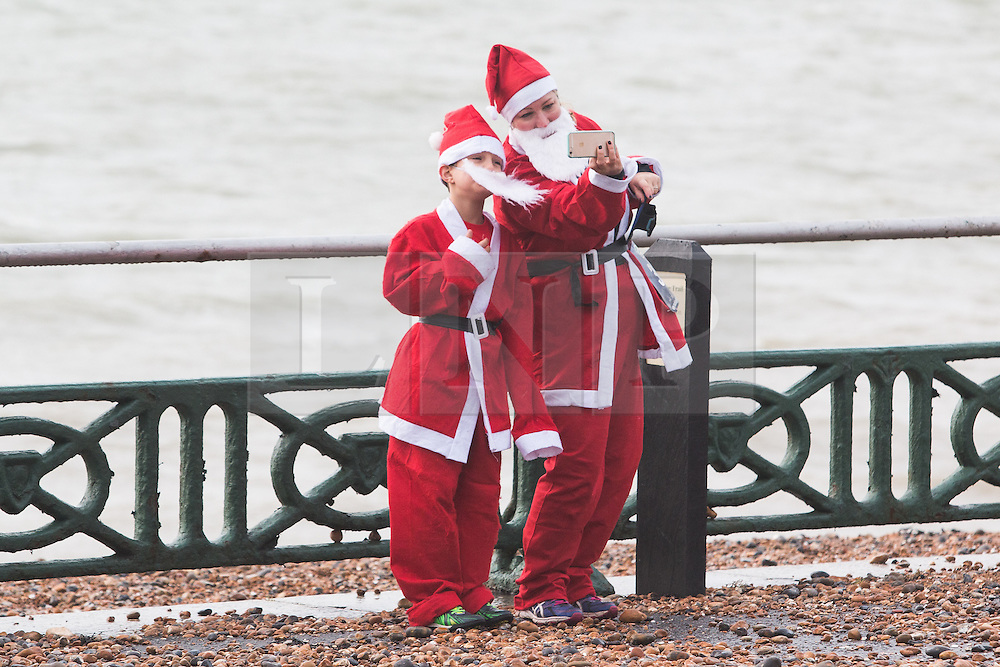 © Licensed to London News Pictures. 12/12//2015. Brighton, UK. Thousands of runners dressed as Santa Claus take part in the yearly Brighton Santa Dash in aid of Brighton's Chidldren's Charity Rockinghorse. Today December 12th 2015. Photo credit: Hugo Michiels/LNP