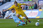 Coventry City defender Dion Kelly-Evans (30) makes a tackle on Bristol Rovers forward Luke James (29) 0-0 during the EFL Sky Bet League 1 match between Coventry City and Bristol Rovers at the Ricoh Arena, Coventry, England on 25 March 2017. Photo by Alan Franklin.