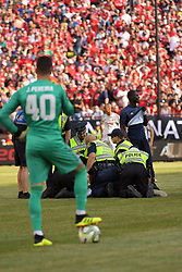 July 28, 2018 - Ann Arbor, MI, U.S. - ANN ARBOR, MI - JULY 28: Police tackle a fan that ran on to the pitch while Manchester United Keeper Joel Pereira (40) looks on during the ICC soccer match between Manchester United FC and Liverpool FC on July 28, 2018 at Michigan Stadium in Ann Arbor, MI (Photo by Allan Dranberg/Icon Sportswire) (Credit Image: © Allan Dranberg/Icon SMI via ZUMA Press)