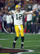 Green Bay Packers quarterback Aaron Rodgers (12) points with both hands and yells out as he celebrates after a fourth quarter play during the NFL NFC Divisional round playoff football game against the Arizona Cardinals on Saturday, Jan. 16, 2016 in Glendale, Ariz. The Cardinals won the game in overtime 26-20. (©Paul Anthony Spinelli)