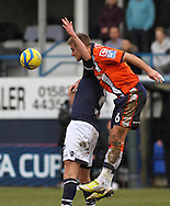 Picture by David Horn/Focus Images Ltd +44 7545 970036.16/02/2013.Janos Kovacs (right).of Luton Town beats Rob Hulse (left) of Millwall during the The FA Cup match at Kenilworth Road, Luton.