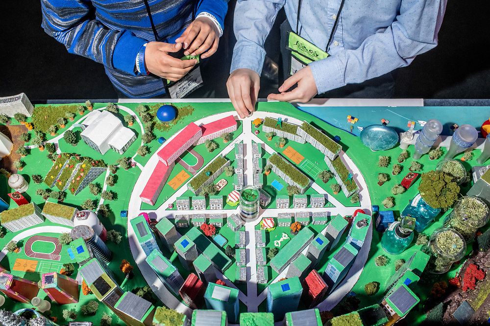 Washington, D.C. - February 20, 2018: Members of the Mid Atlantic team from the Edlin School in Restin, Va., Nikhil Kuntipuram, 6th grade, left, and Lucas Ribero, 7th, set up their city named Halona before their presentation during the Future City Competition Finals at the Hyatt Regency Washington on Capitol Hill in Washington, D.C., Tuesday, Feb. 20, 2018.<br /> <br /> The Mid Atlantic team won first place.<br /> <br /> CREDIT: Matt Roth