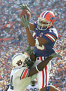Gainesville, Fl -GATORS- 10/14/00 -University of Florida Jabar Gaffney catches pass from Rex Grossman for a touchdown while being defended by  Auburn's Larry Casher  Saturday afternoon in Gainesville.(staff/Scott Iskowitz)