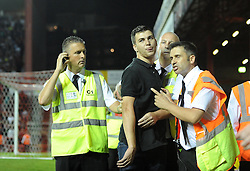 Bristol Rovers' fan gets escorted by stewards  - Photo mandatory by-line: Dougie Allward/JMP - Tel: Mobile: 07966 386802 04/09/2013 - SPORT - FOOTBALL -  Ashton Gate - Bristol - Bristol City V Bristol Rovers - Johnstone Paint Trophy - First Round - Bristol Derby