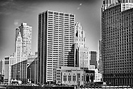 A Photo of Wrigley Building from the banks of the Chicago River. Wrigley building is based on the North of the river, on North Michigan Avenue. The building was designed by the architecture firm  Graham, Anderson, Probst & White.