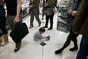 little child sitting and crying as it lost its mother in a large department store