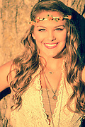 Closeup of a Brentwood area high school Senior at sunset smiling with a flower crown