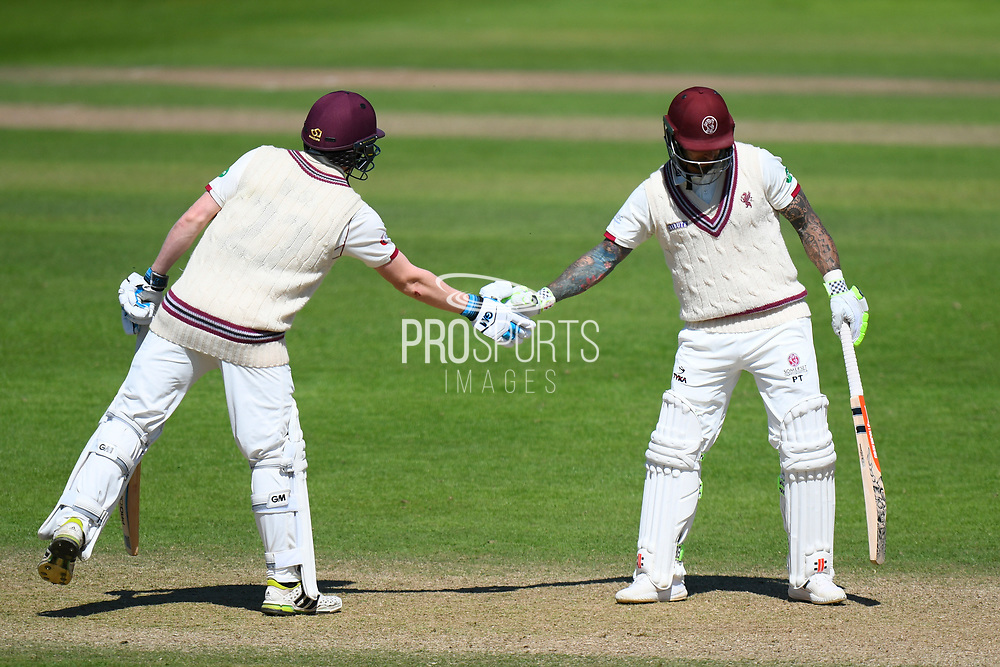 50 for Peter Trego - Peter Trego of Somerset is congratulated on scoring his half century by Dom Bess of Somerset during the Specsavers County Champ Div 1 match between Somerset County Cricket Club and Warwickshire County Cricket Club at the Cooper Associates County Ground, Taunton, United Kingdom on 22 May 2017. Photo by Graham Hunt.
