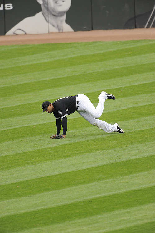 CHICAGO - MAY 21:  Alex Rios #51 of the Chicago White Sox makes a tumbling catch in the outfield against  the Los Angeles Dodgers on May 21, 2011 at U.S. Cellular Field in Chicago, Illinois.  The White Sox defeated the Dodgers 9-2.  (Photo by Ron Vesely)  Subject:   Alex Rios