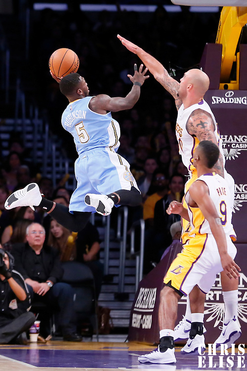23 November 2014: Denver Nuggets guard Nate Robinson (5) goes for the layup against Los Angeles Lakers center Robert Sacre (50) during the Denver Nuggets 101-94 overtime victory over the Los Angeles Lakers, at the Staples Center, Los Angeles, California, USA.