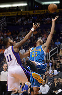Apr 7, 2013; Phoenix, AZ, USA; New Orleans Hornets forward Anthony Davis (23) reaches for the ball against the Phoenix Suns forward Markieff Morris (11) in the second half at US Airways Center. The Hornets defeated the Suns 95-92. Mandatory Credit: Jennifer Stewart-USA TODAY Sports