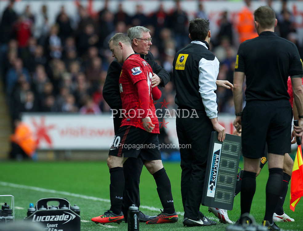 SWANSEA, WALES - Sunday, December 23, 2012: Manchester United's Wayne Rooney is substituted by manager Alex Ferguson during the Premiership match against Swansea City at the Liberty Stadium. (Pic by David Rawcliffe/Propaganda)