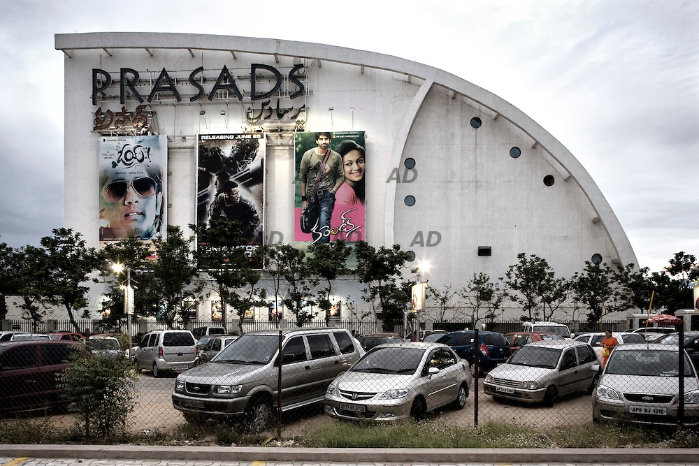 The Prasad's IMAX multiplex theatre is the temple of movies in Hyderabad. The Prasad's IMAX theater features world's most powerful projector that beams on 29 meters wide and 21.93 meters high screen. It also has a six channel sound system that puts across 12,000 watts of digital surround sound. There are 44 custom designed speakers equipped at strategic places in the theater to give the complete digital experience. This IMAX screen has 15-perforation and 70 mm format instead of usual 5-perforation and 70mm format. The 'rolling loop' technique ensures the smooth run of the movie on the screen. This Prasad's entertainment center, the first Multiplex theatre in Hyderabad, also sports five 70 mm screens along with the IMAX screen. Out of these five screens, four are being used for public exhibition and one screen is reserved for private shows. Along with the screen, the Prasad's also has foot courts and shopping malls that are spread over three floors of approximately 70,000 sq feet. *** General Caption *** The Telugu film industry is the second biggest film industry (sometimes called Tollywood) based in Hyderabad. Telugu is the second largest spoken language in India. After Bollywood, more movies are produced here every year, in Telugu as in any other language. The Ramoji Film City, founded by Cherukuri Ramoji Rao, better known as Ramoji Rao, an Indian businessman and media entrepreneur, also has what is claimed to be the largest film studio in the world. The Film City, opened in 1996, spread over 2,000 acres of land studded with hills, vales and lakes, has few parallels as both a tourist attraction and major film-making facility. The city encompasses massive buildings, gardens and other sets suitable for filming movies. Inside the city are complete facilities for pre-production, production and post-production work on movies. In addition, there are theme parks, rides and other attractions, opportunities for shopping and dining. There are three hotels inside the city ca