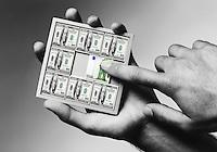 Man solving economic puzzle