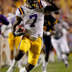 Sep 25, 2010; Baton Rouge, LA, USA; LSU Tigers cornerback Patrick Peterson (7) returns a punt against the West Virginia Mountaineers during the first half at Tiger Stadium.  Mandatory Credit: Derick E. Hingle