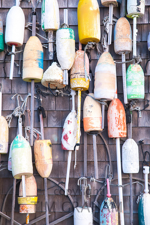 Colourful lobster buoys on oak shingle at Captain Cass - Cap't Cass Rock Harbor Seafood Cafe at Orleans, Cape Cod, New England, USA