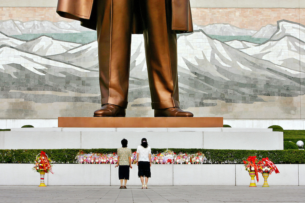 North Korean women prepare to bow before the statue late North Korean President Kim Il Sung erected on Mansu Hill in Pyongyang, North Korea Sunday Aug. 5, 2007.