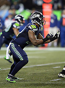 Seattle Seahawks outside linebacker Bruce Irvin (51) makes a move during the NFL week 19 NFC Divisional Playoff football game against the Carolina Panthers on Saturday, Jan. 10, 2015 in Seattle. The Seahawks won the game 31-17. ©Paul Anthony Spinelli