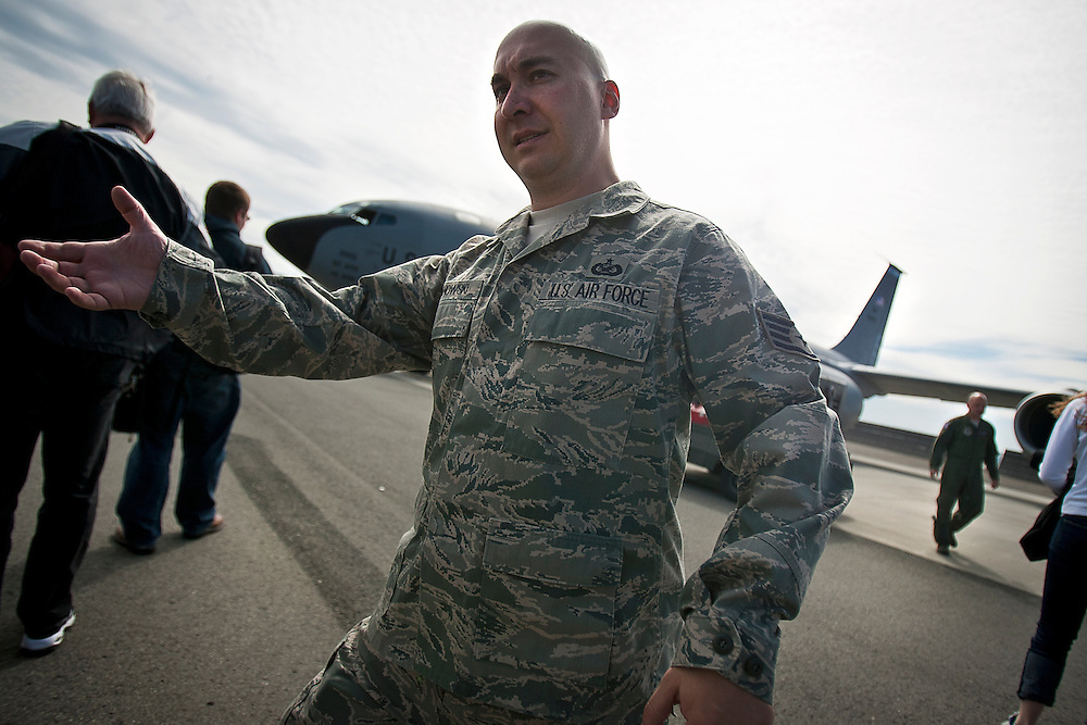 Sgt. Buzanowski directs members of the media on the tarmac before they entered onto the KC-135R for the Thunderbird refueling mission...