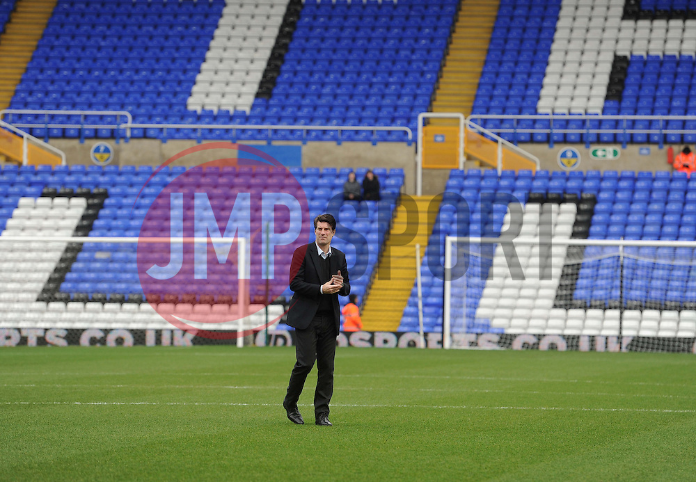 Swansea City Manager, Michael Laudrup walks the pitch poor to kick off. - Photo mandatory by-line: Alex James/JMP - Tel: Mobile: 07966 386802 25/01/2014 - SPORT - FOOTBALL - St Andrew's - Birmingham - Birmingham City v Swansea City - FA Cup - Forth Round