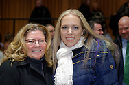 Hempstead, New York, USA. January 1, 2018. L-R, EILEEN NAPOLITANO and SUE MOLLER pose in audience after Swearing-In ceremony of LAURA GILLEN as Hempstead Town Supervisor, and SYLVIA CABANA as Hempstead Town Clerk are held at Hofstra University.
