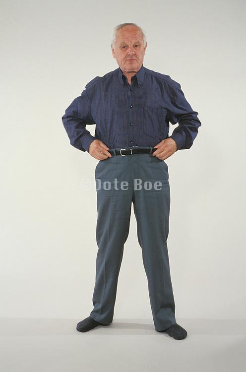 older man all dressed up to go